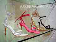 Shoe art of four ankle strap high heels in assorted colors